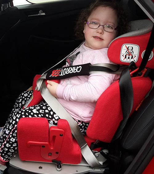 Gemma in her adapted car seat