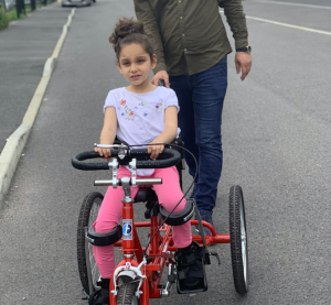 Jury Ismail with her adapted trike