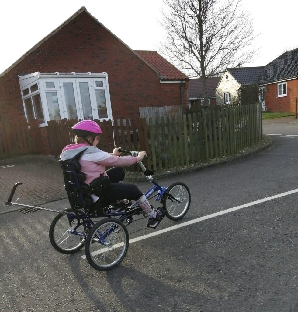 Brooke enjoying her adapted Tomcat trike