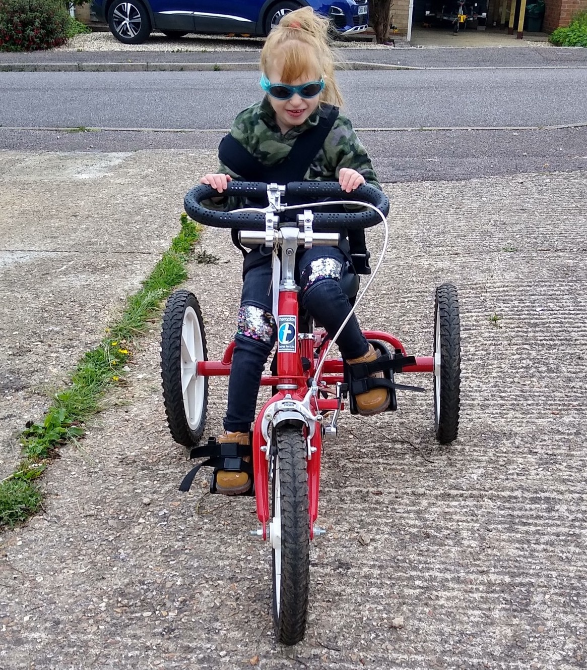 Jaydi trying out an adapted trike