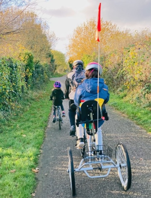 The 10-year-old has been out on family bike rides every weekend since receiving her adapted trike