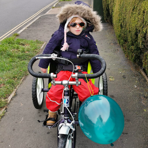 Little Jaydi has been wrapping up warm and making the most of her new adapted trike