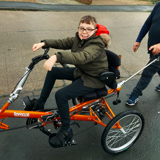 13-year-old Harley, who has severe learning difficulties, was awarded a grant from Children Today for his adapted trike