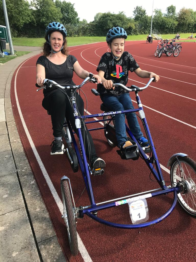 Claire and Sam trying out the adapted trike which is the ideal solution for the pair