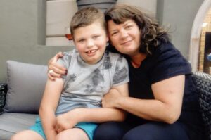 15-year-old Reece pictured with his mum, Sharon