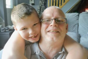 Reece pictured with his dad, Ste