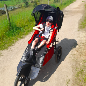Tommy adores his adapted buggy and is always asking to go out in it.